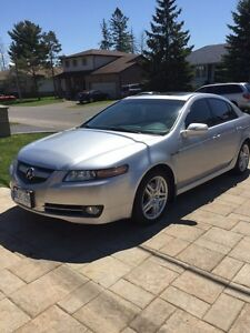 A clean Acura TL with safety and e test  .car starter.