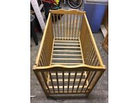 FREE Wooden drop side baby cot