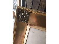 Golden framed mirror