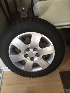 winter tires with rims and covered  215 60 16