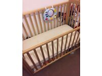 Baby cot with mattress and mattress cover