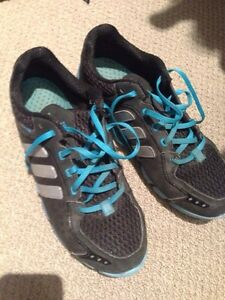 Adidas running shoes and silver heels
