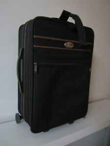 Small suitcase made of durable canvas $14