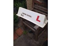 Driving School roof sign.
