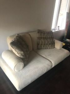 2 seater Beige Couch for sale