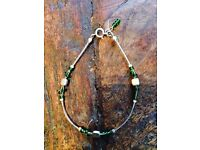 A very pretty designer one off bracelet in wire work with delicate green beads.