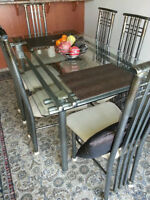 Dining table, chairs and area rug