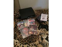 Ps3 console, remote, and 5 games