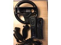Nintendo Wii Black, 2 controllers, 2 nunchucks, Mario Kart Wheel + Mario Kart Disc