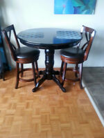 Space-saver table and swivel stools