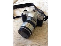**Pentax MZ7 manual SLR camera with extended zoom lens. As new condition
