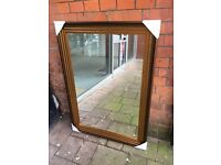 large gold ribbed framed mirror