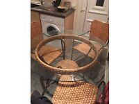 Glass table and wicker chairs