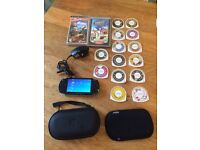 PSP console with games, charger, carry case