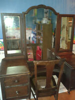 Antique vanity with chair.
