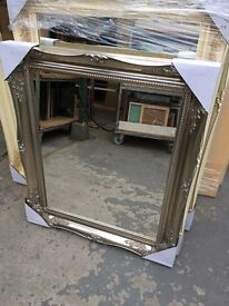 silver swept framed wooden mirror