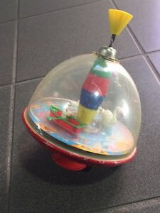 Vintage LBZ German toy spinning top water theme. 60's