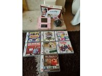 Pink nintendo DS Lite still in box with charger and with 7 Games