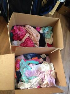 Two boxes of baby girl clothes