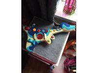 For sale children's award winning Woofer hound guitar