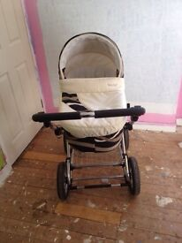 Baby pram, bouncy chair, travel coat with baby changing mat, baby monitor and steriliser.