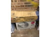 LG air con wall unit and fan for sale - brand new