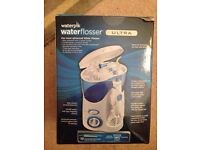 Waterpik water flosser brand new
