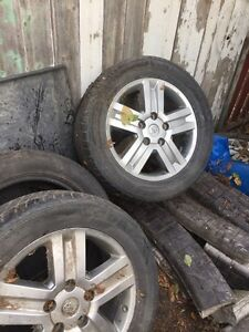 Set of tundra rims and tires 6 tires