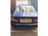 Blue BMW petrol car