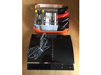 PlayStation 3 Game Console with games and cables and controllers