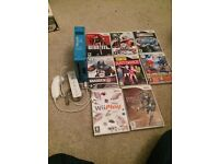 Blue Nintendo Wii and games