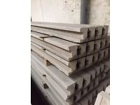Slotted concrete fence post