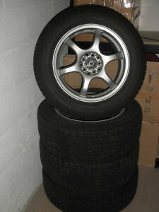 FOUR YOKOHAMA WINTER TIRES ON ALLOY RIMS