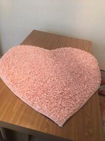 Pink textured heart shape rug