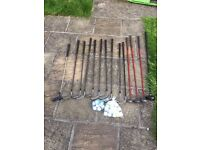 Selection of golf clubs and balls