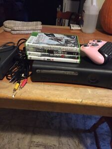 Xbox 360 with 4 games and controller