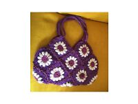 Purple crocheted handbag