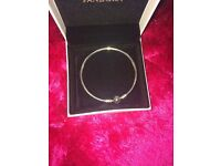 Pandora bracelet and earrings never worn still in box and gift bag