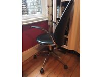 Gorgeous black leather swivel chair for home office