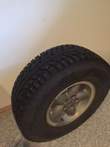 Hankooks studded on jeep rims .used only 1 month Prince George British Columbia image 1