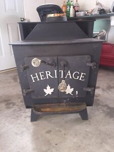 Selling Great Condition Cast-Iron Wood Stove + Piping $950 obo