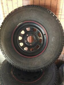 265/75/16  Arctic Claw studded winters on rims