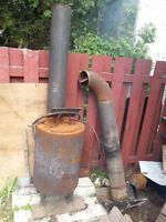 poele a bois pour garage ou extérieur avec cheminer  75$