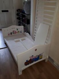 Toddle bed/cotbed with lots of bedding