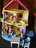 Fisher price dollhouse with Asian and Caucasian dolls
