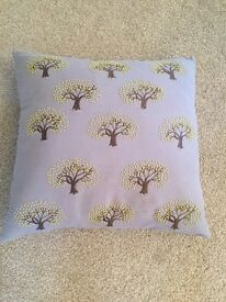 Pair of cushions with lime green bead detail