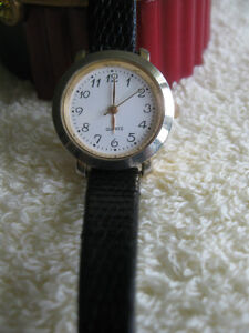LADY'S ATTRACTIVE WRIST WATCH with GENUINE LIZARD LEATHER STRAP.