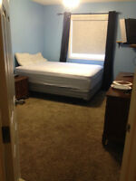 Large Bedroom for rent in Chestermere. Available Immediately