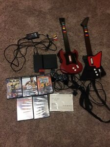 PlayStation 2, with 5 games, 1 controller 2 guitars