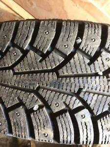 4 Studded Nokian winter tires and rims for a Subaru Forester/Cro
